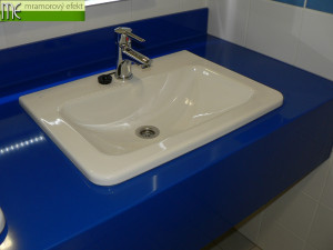 The Park of Science and Technology in Ostrava_blue and yellow countertops with rectangular holes for  integrated ceramic washbasins